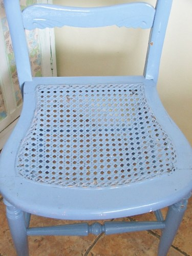Wooden chair with chippy paintwork