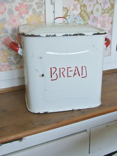 Vintage red and white enamel bread bin