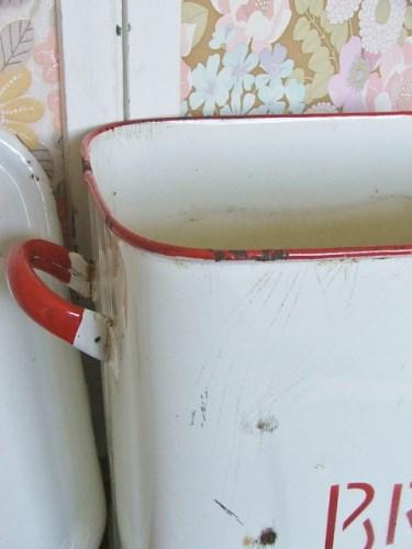 Old worn enamel bread bin