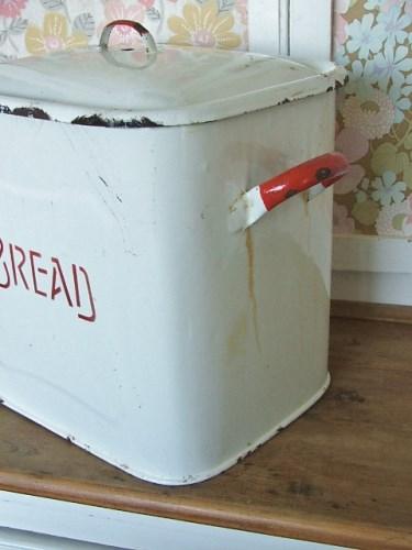 Old worn vintage enamel bread bin