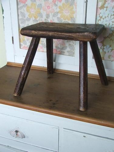 Old worn vintage wooden stool