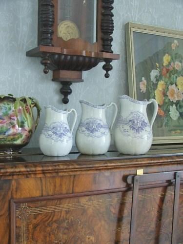 Three Wreath Pottery Jugs