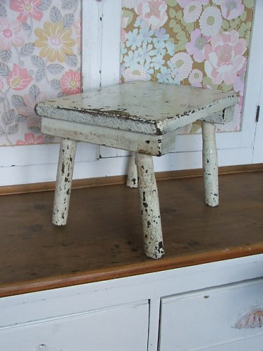 Wooden stool with chippy white paintwork
