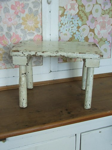 Old wooden stool with original white chipped paintwork