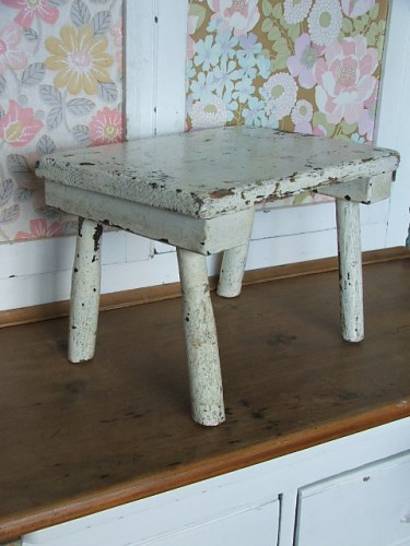 Old wooden painted milking stool