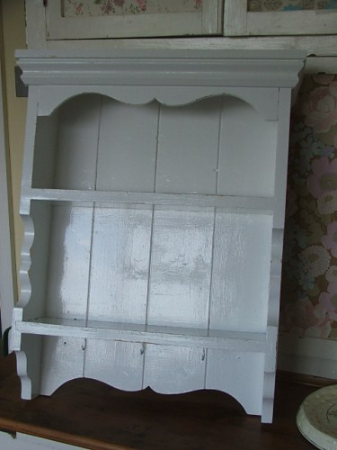 white painted wooden shelving unit