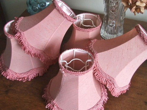 Five small pink lampshades