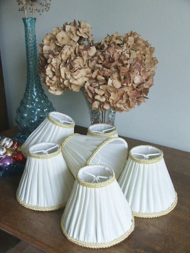 Six white with gold trim lampshades