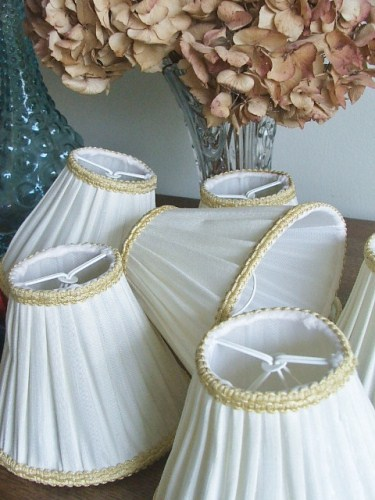 Six creamy white with gold trim lampshades
