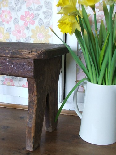 Old shabby vintage wooden stool