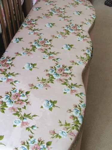 Pretty vintage pink floral wicker ottomon