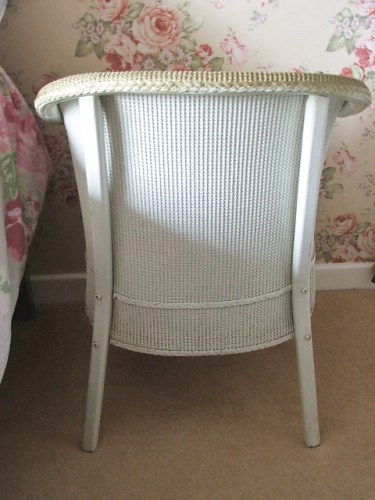 Vintage wicker chair with floral seat