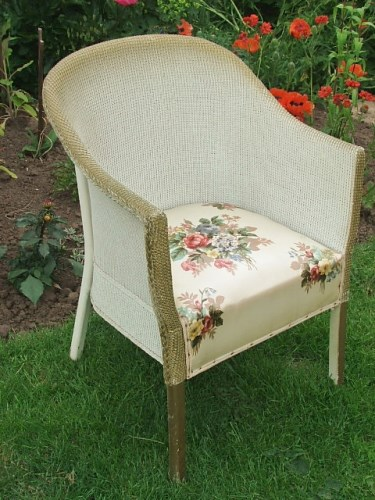 White wickr chair with floral seat