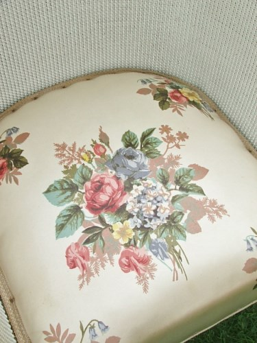 White wicker chair with pretty floral seat