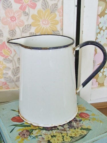 Small worn vintage enamel jug